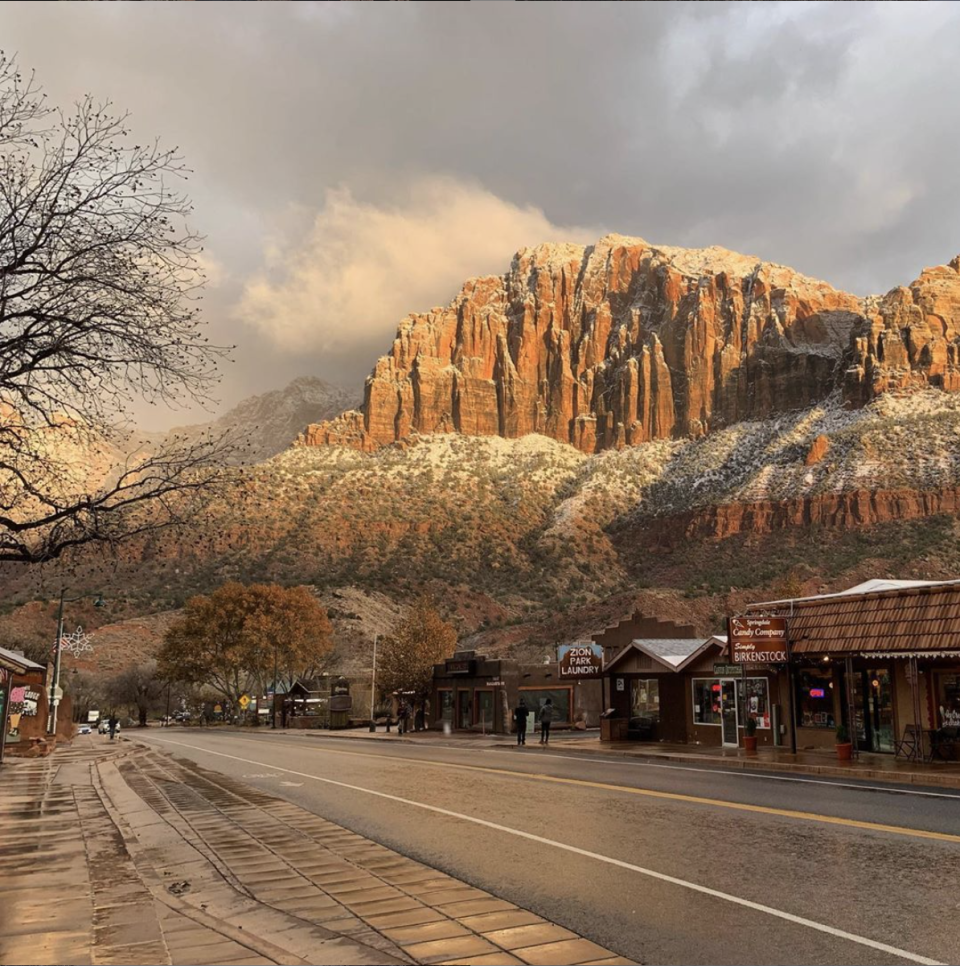 """<p>Right at the edge of Zion National Park sits a <a href=""""https://www.tripadvisor.com/Tourism-g61001-Springdale_Utah-Vacations.html"""" rel=""""nofollow noopener"""" target=""""_blank"""" data-ylk=""""slk:small village"""" class=""""link rapid-noclick-resp"""">small village</a> where visitors can soak up the breathtaking mountain-scape as they enjoy dining at the local brewery or shopping at one of the many crystal and geode shops.</p>"""