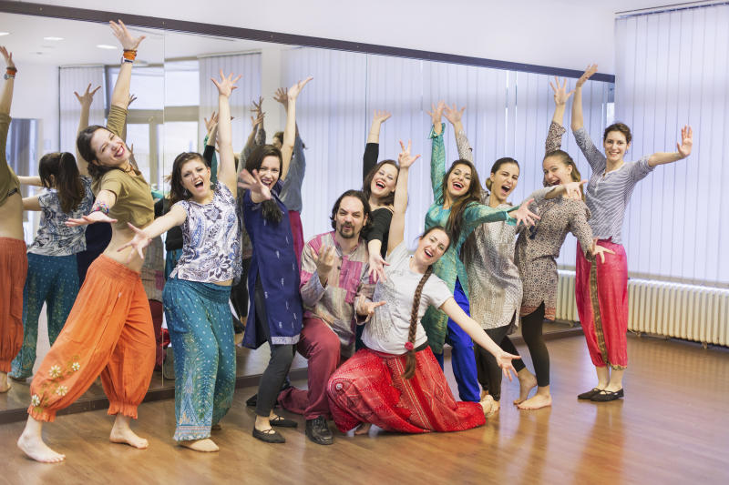 Group of bollywood dancers in dance studio.