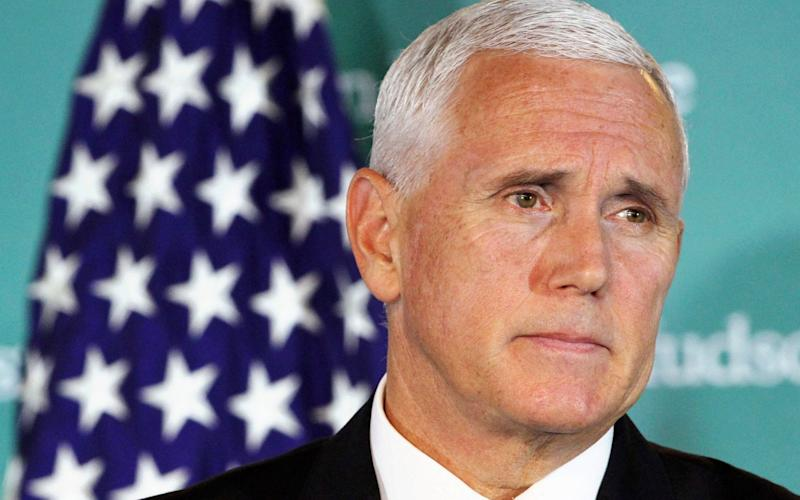 Mike Pence, the US vice president, was in Miami on Friday to rally Venezuelan exiles to support Juan Guaido - AP