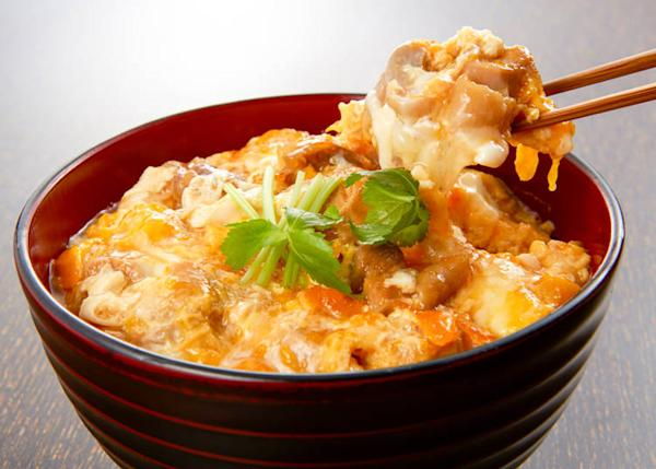 Oyakodon is chicken and eggs simmered in sauce and served over rice.