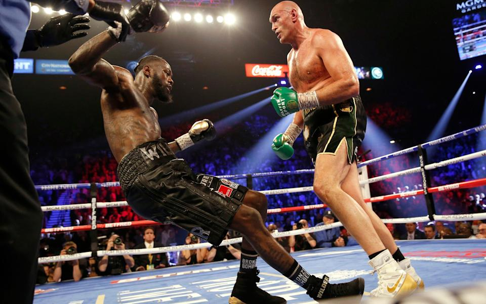 Deontay Wilder andTyson Fury -Deontay Wilder's trainer deserves a bonus, not the sack – he saved his career and may have saved his life too - REUTERS