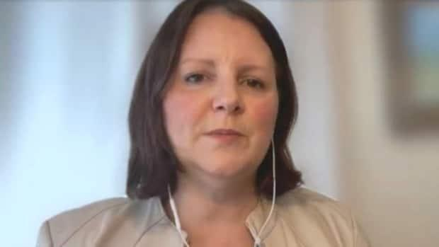 Dr. Jennifer Russell, New Brunswick's chief medical officer of health, participated in Friday's COVID update remotely because she is self-isolating for 72 hours as a result of her contact with an affected school. (CBC - image credit)