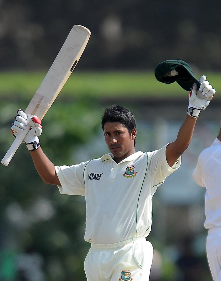 Bangladeshi cricketer Mohammad Ashraful raises his bat as he acknowledges the crowd after completing 150 runs during the third day of the opening Test match between Sri Lanka and Bangladesh at the Galle International Cricket Stadium in Galle on March 10, 2013.  AFP PHOTO/ LAKRUWAN WANNIARACHCHI        (Photo credit should read LAKRUWAN WANNIARACHCHI/AFP/Getty Images)