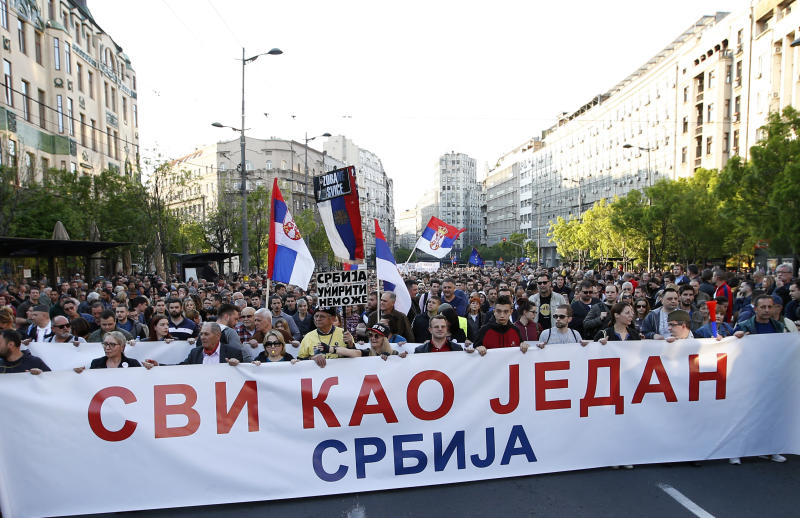People hold a banner that reads: ''All as one - Serbia'' during a protest march against president Aleksandar Vucic in Belgrade, Serbia, Saturday, April 20, 2019. Thousands of people have rallied in Serbia's capital for 20th week in a row against populist President Aleksandar Vucic and his government. (AP Photo/Darko Vojinovic)
