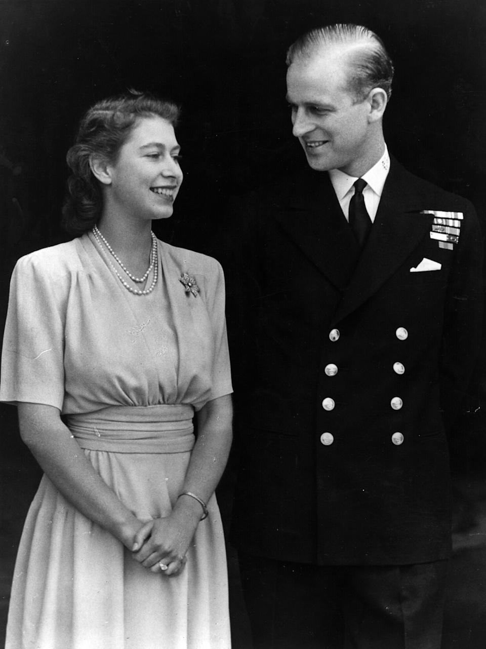 1947:  H R H Princess Elizabeth and Philip Mountbatten, Duke of Edinburgh, on the occasion of their engagement at Buckingham Palace in London.  (Photo by Fox Photos/Getty Images)