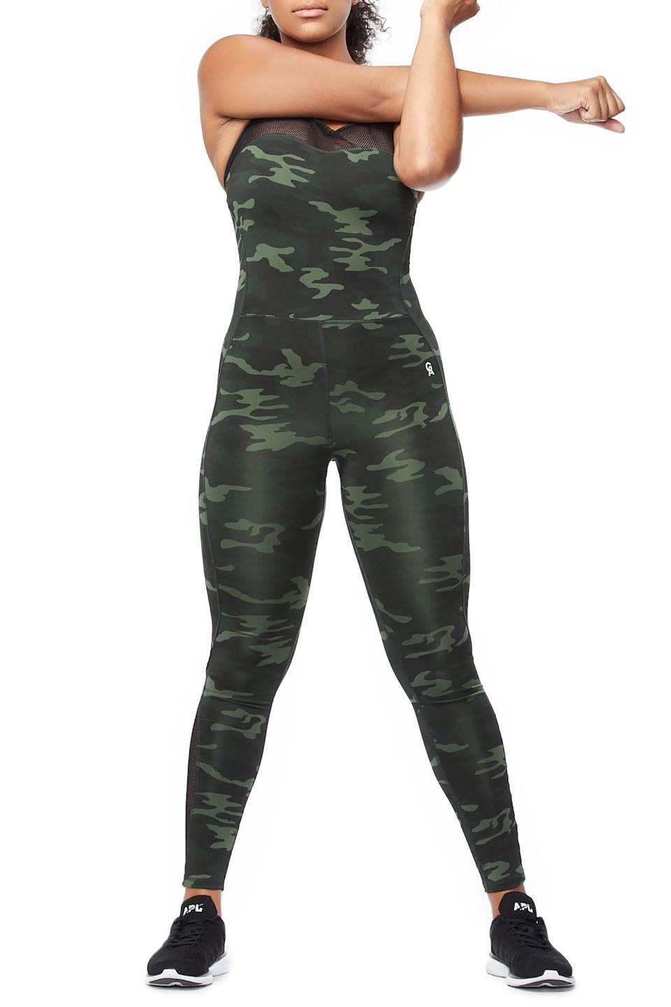 "<p>This full-body camo jumpsuit has mesh details with extra bust support so you don't have to worry about wearing another sports bra underneath.<br><a href=""https://fave.co/2VrSm3z"" rel=""nofollow noopener"" target=""_blank"" data-ylk=""slk:Shop it:"" class=""link rapid-noclick-resp""><strong>Shop it:</strong> </a>The Curve Sculpt Jumpsuit, $159 (take 25% off with code EXTRA25), <a href=""https://fave.co/2VrSm3z"" rel=""nofollow noopener"" target=""_blank"" data-ylk=""slk:goodamerican.com"" class=""link rapid-noclick-resp"">goodamerican.com</a> </p>"