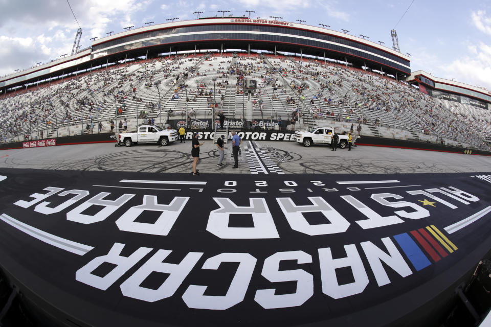 Fans wait for the start of a NASCAR All-Star Open auto race at Bristol Motor Speedway in Bristol, Tenn, Wednesday, July 15, 2020. (AP Photo/Mark Humphrey)