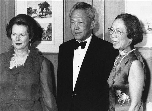Prime Minister of Singapore Lee Kuan Yew and his wife, Kwa Geok Choo, right, on their arrival at No. 10 Downing Street in London where they are dining with Premier Margaret Thatcher, July 13, 1982 . Mr. and Mrs. Lee are on an official visit as guests of the government until July 17th. (AP Photo/Press Association)