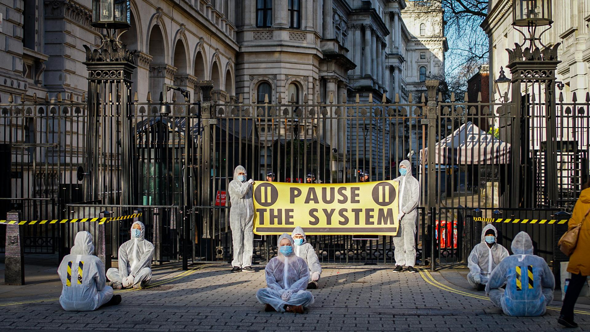 Protestors wearing hamzat suits congregated outside Downing Street on Monday to demand action on coronavirus.
