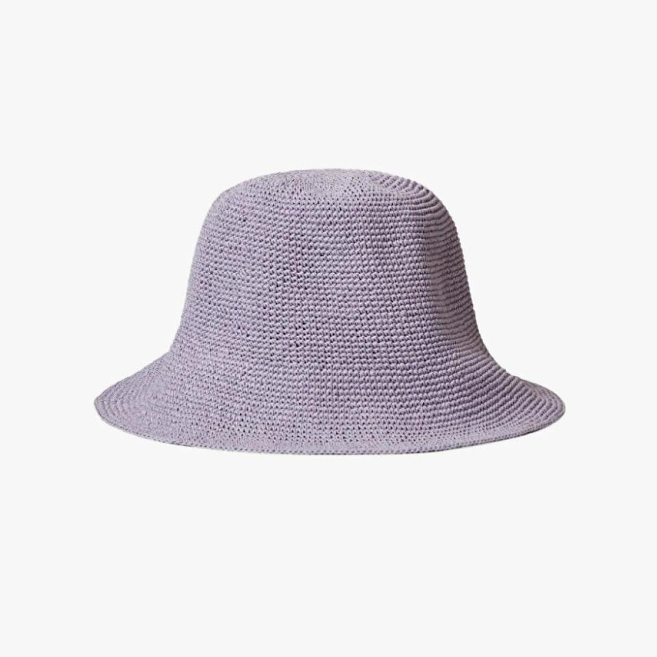 """Cos is offering 25% off their entire collection through Monday, May 31. $45, COS. <a href=""""https://www.cosstores.com/en_usd/women/accessories/hats-scarves-and-gloves/product.crochet-paper-hat-purple.0833201004.html"""" rel=""""nofollow noopener"""" target=""""_blank"""" data-ylk=""""slk:Get it now!"""" class=""""link rapid-noclick-resp"""">Get it now!</a>"""