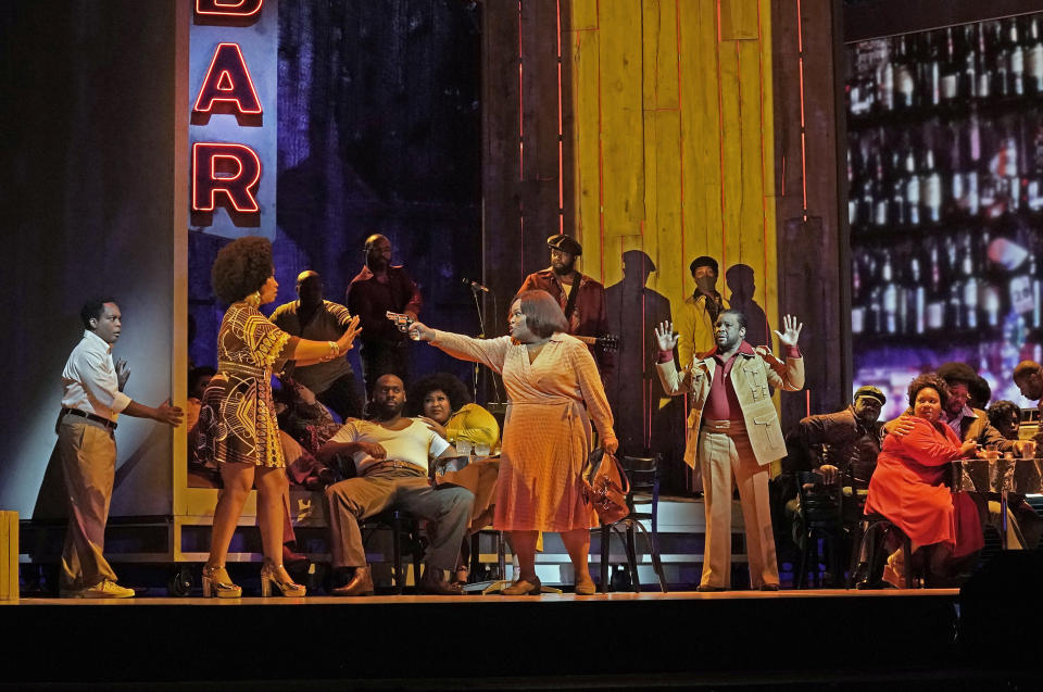"""This Sept. 17, 2021 image released by the Metropolitan Opera shows Latonia Moore as Billie, center, and the cast during a rehearsal for Terence Blanchard's """"Fire Shut Up in My Bones,"""" opening the Metropolitan Opera season on Sept. 27. (Ken Howard/Met Opera via AP)"""