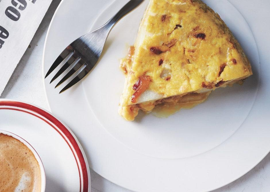 """Here's your chance to master one of Spain's classic tapas: tortilla española. The key is to leave the eggs slightly undercooked; that's what gives this a custardy (not bouncy) texture. <a href=""""https://www.bonappetit.com/recipe/tortilla-espanola?mbid=synd_yahoo_rss"""" rel=""""nofollow noopener"""" target=""""_blank"""" data-ylk=""""slk:See recipe."""" class=""""link rapid-noclick-resp"""">See recipe.</a>"""