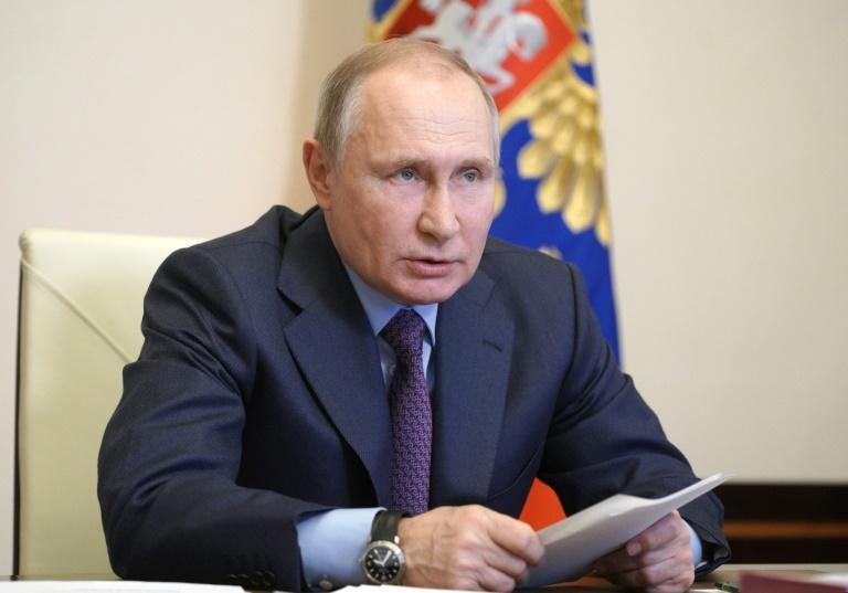 Putin urged Russians not to listen to 'people who spread rumours' about vaccines