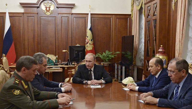 Russian President Vladimir Putin (C) meets with Defence Minister Sergei Shoigu (2ndL), Army chief of staff Valery Gerasimov (L), head of the FSB Alexander Bortnikov (2ndR) and Foreign Minister Sergei Lavrov in Moscow on November 17, 2015