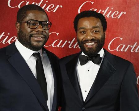 """British film director McQueen poses backstage with the star of his film Ejiofor from """"12 Years A Slave"""" after winning Director of the Year at the 2014 Palm Springs International Film Festival Awards Gala in Palm Springs"""