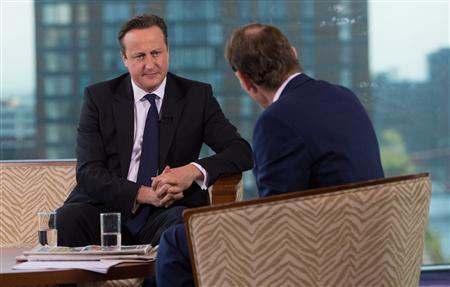 Britain's Prime Minister David Cameron listens as he appears on the BBC's Andrew Marr Show, on the first day of the of the Conservative Party annual conference in Manchester