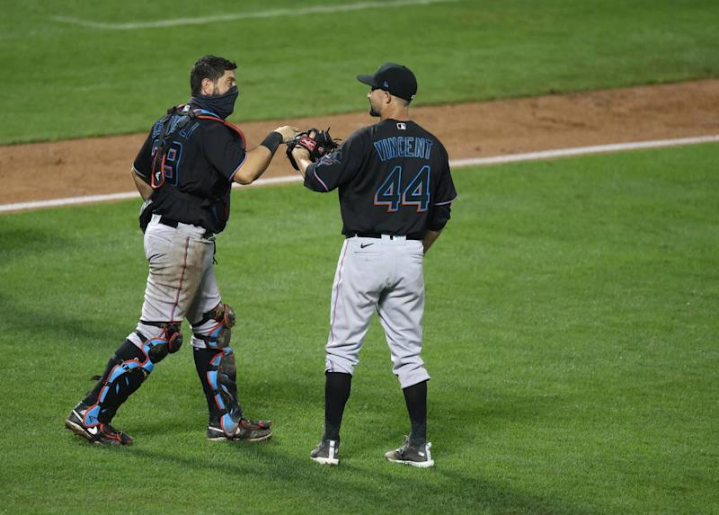 Francisco Cervelli #29 and Nick Vincent #44 of the Miami Marlins celebrate a 4-3 win against the New York Mets during their game at Citi Field on August 07, 2020 in New York City.