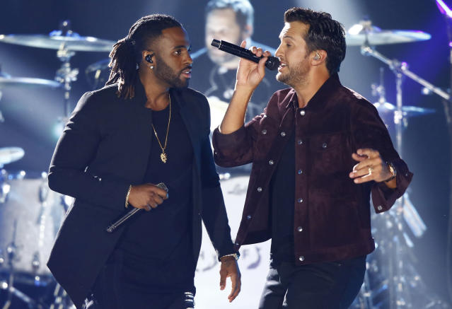 <p>Jason Derulo, left, and Luke Bryan perform at the CMT Music Awards at Music City Center on Wednesday, June 7, 2017, in Nashville, Tenn. (Photo by Wade Payne/Invision/AP) </p>