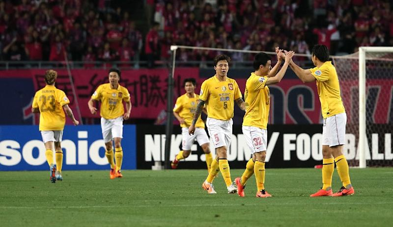 China's Guangzhou Evergrande players celebrate after scoring a goal during an AFC Champions League match in Osaka, in May 2014