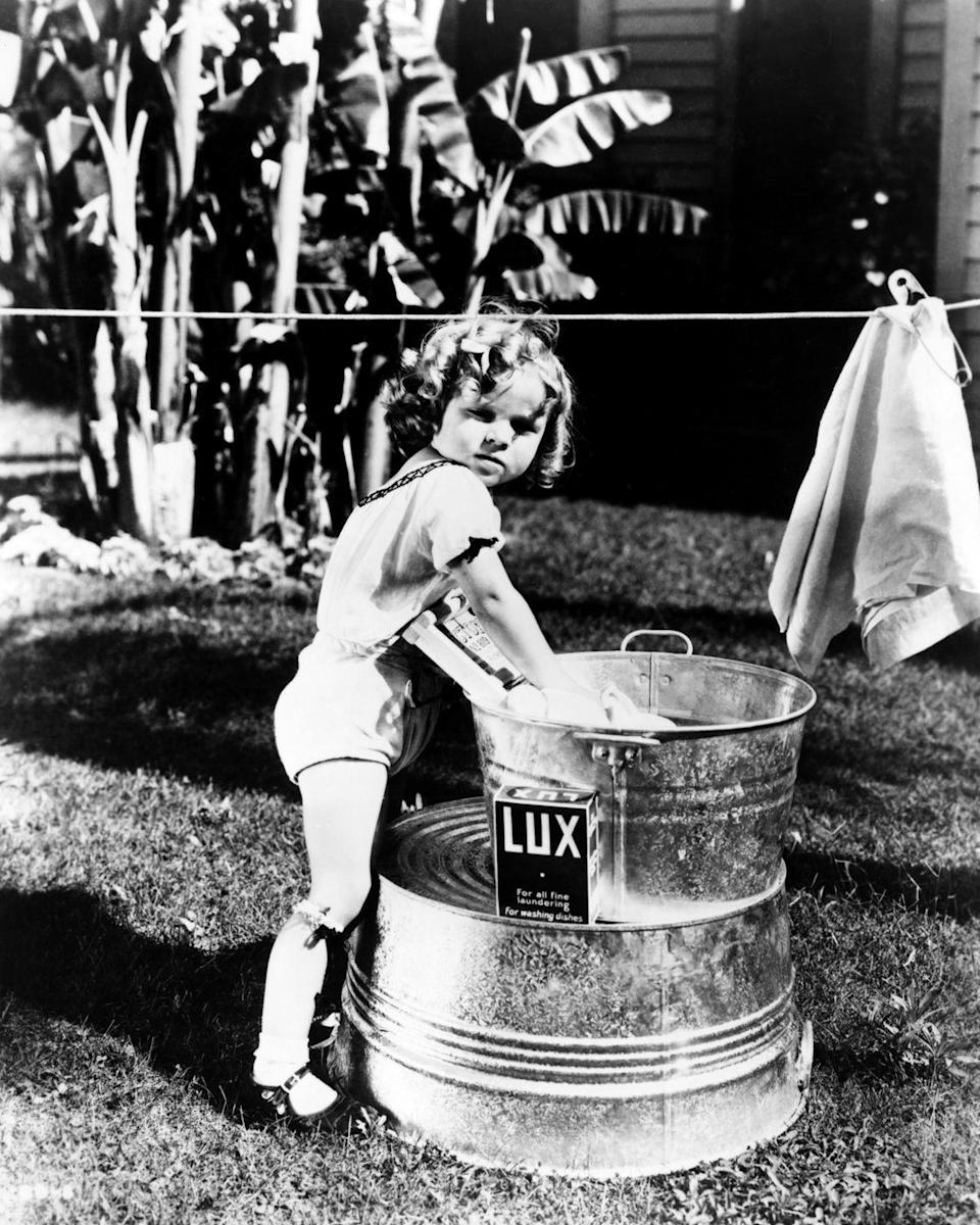 <p>Shirley Temple shown in a promotional image for her first acting role in a series of ten-minute shorts called <em>Baby Burlesks</em>.</p>