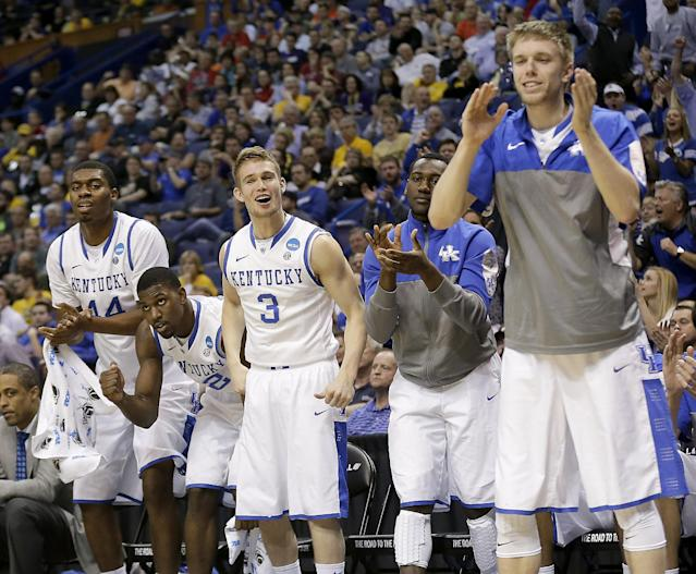 Kentucky players celebrate a basket during the second half of a second-round game against Kansas State in the NCAA college basketball tournament, Friday, March 21, 2014, in St. Louis. Kentucky won the game 56-49. (AP Photo/Charlie Riedel)