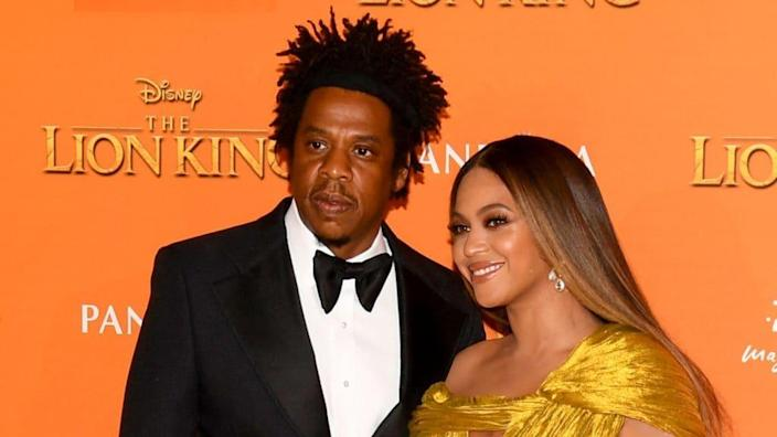 """Jay-Z and Beyonce Knowles-Carter are shown at the European premiere of Disney's """"The Lion King"""" in July 2019 in London. (Photo by Gareth Cattermole/Getty Images for Disney)"""
