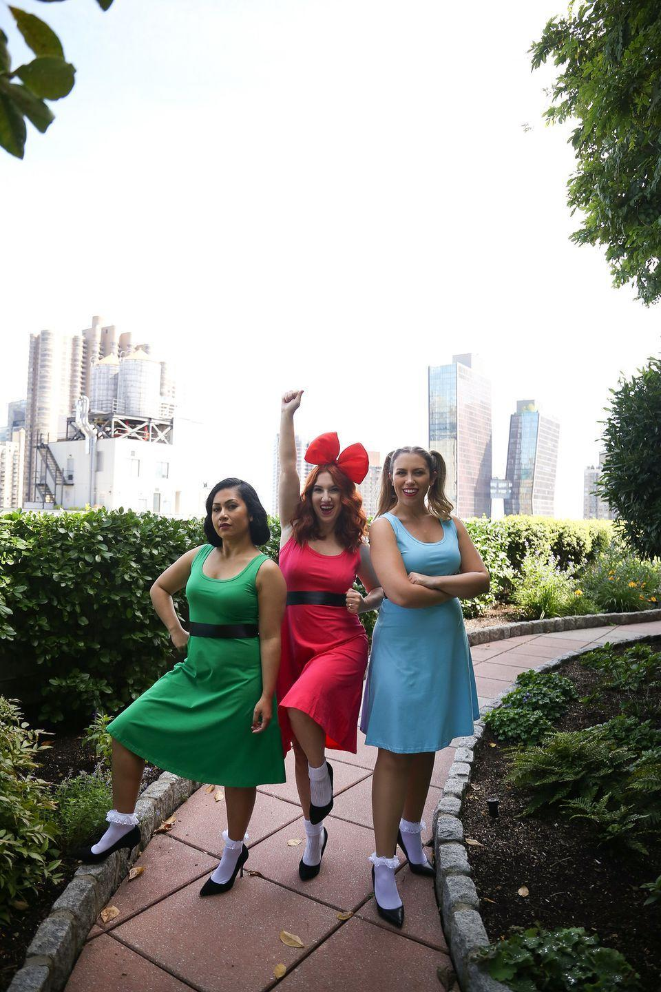 """<p>First, figure out which of your friends identify closest with Blossom, Buttercup, and Bubbles. Then dress the part with colored dresses that match each character's costume. </p><p><em><a href=""""http://livingaftermidnite.com/2019/10/group-halloween-costumes-that-will-win-you-best-dressed.html"""" rel=""""nofollow noopener"""" target=""""_blank"""" data-ylk=""""slk:Get the tutorial at Living After Midnite >>"""" class=""""link rapid-noclick-resp"""">Get the tutorial at Living After Midnite >></a><br></em></p>"""