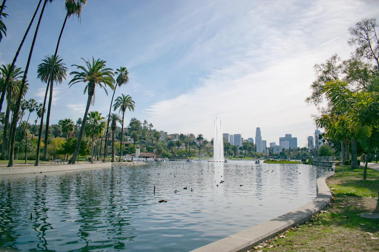 """<p><strong>What's the vibe here?</strong> Echo Park Lake is in dozens of movies and TV shows, but it remains one of the most down-to-earth spots in Los Angeles. Since its renovation in 2014, the lake has become even more of a meeting point, picnic spot, and jogger's paradise. With plenty of ducks, swan-shaped pedal boats available for rent, and lotuses floating on the man-made body of water, the lake is a family-friendly and date-friendly destination, complete with a fountain that continuously shoots a stream of water 200 feet into the air. And there's plenty of street food options if you get peckish—try to find the lady who cooks blue flour quesadillas.</p> <p><strong>Any standout features or must-sees?</strong> Rent a swan-shaped pedal boat and cruise around the lake. The lotus garden is also excellent; a Lotus Festival every July features dancing dragons and ornately decorated longboats.</p> <p><strong>Was it easy to get around?</strong> You can see the lake from one end the other—and it'seasy to navigate. The lotuses are on the west side and the picnic hill and pedal boat rentals are on the east side. There are plenty of open benches, and the jogging path is a simple one-mile loop.</p> <p><strong>What—and who—is this best for?</strong> Echo Park Lake is perfect for families looking for an outdoorsy afternoon in notoriously unwalkable <a href=""""https://www.cntraveler.com/destinations/los-angeles?mbid=synd_yahoo_rss"""">L.A.</a>; anyone looking for a relaxing picnic; and couples looking for an alternative daytime date. Joggers delight at the wide path, as do those who love to see famous filming locations—classic scenes from <em>Chinatown</em> (1974) and Charlie Chaplin's <em>Twenty Minutes of Love</em> (1914) were both filmed here, as was the swan boat scene from <em>Under the Silver Lake</em> (2018). If you're looking for landmarks or cultural heritage—or if you're constrained by a strict itinerary—Echo Park Lake might not be the right choice.</p>"""