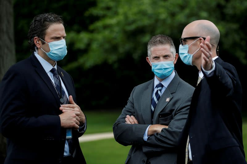 FILE PHOTO: U.S. Secret Service agents gather for coronavirus tests prior to Trump departure on travel to Florida at the White House in Washington
