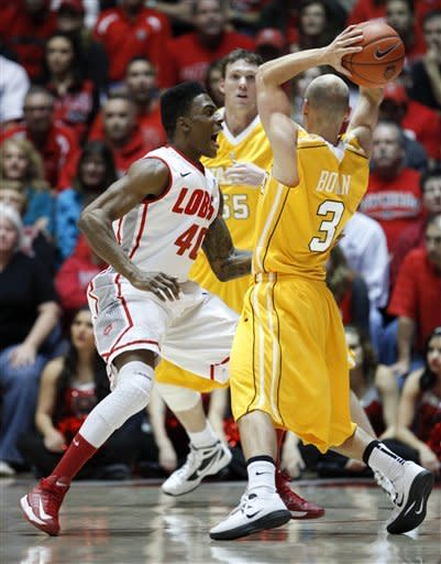 New Mexico's Demetrius Walker, left, yells in the face of Valparaiso's Will Bogan (3) during the first half of an NCAA college basketball game at University Arena in Albuquerque, N.M., Saturday, Dec. 8, 2012. (AP Photo/Craig Fritz)