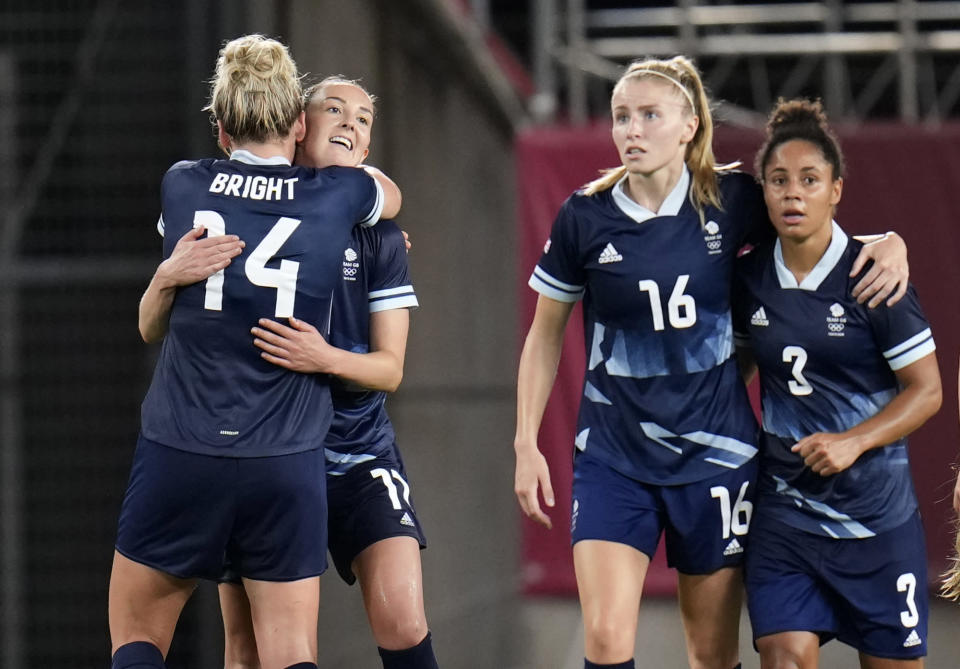Britain's Caroline Weir, 2nd left, celebrates with teammate Millie Bright after scoring her side's opening goal against Canada during a women's soccer match at the 2020 Summer Olympics, Tuesday, July 27, 2021, in Kashima, Japan. (AP Photo/Fernando Vergara)
