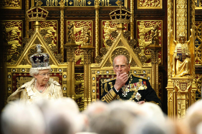 FILE - In this May 25, 2010 file photo, Britain's Queen Elizabeth II sits on the throne beside Prince Philip, right, in the House of Lords prior to delivering the Queen's Speech at the Palace of Westminster in London. Spain's Crown Princess Letizia has a penchant for haute couture. Queen Elizabeth II's Bentley's are spotless. Belgium's King Albert II maintains a sumptuous villa in the south of France. But believe it or not, many of Europe's royals are feeling a pinch of the austerity sweeping the continent as it deals with its debt crisis. (AP Photo/Alastair Grant, Pool-File)