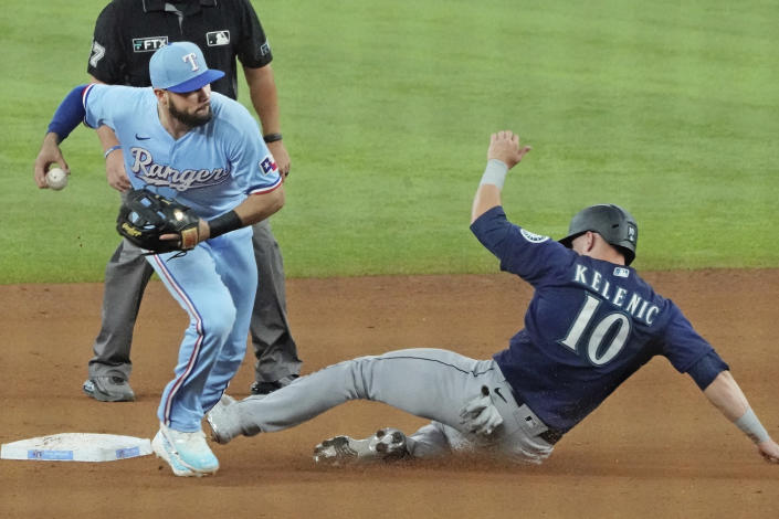 Texas Rangers shortstop Isiah Kiner-Falefa forces Seattle Mariners' Jarred Kelenic (10) at second base in the fourth inning of a baseball game, Sunday, Aug. 1, 2021, in Arlington, Texas. (AP Photo/Louis DeLuca)