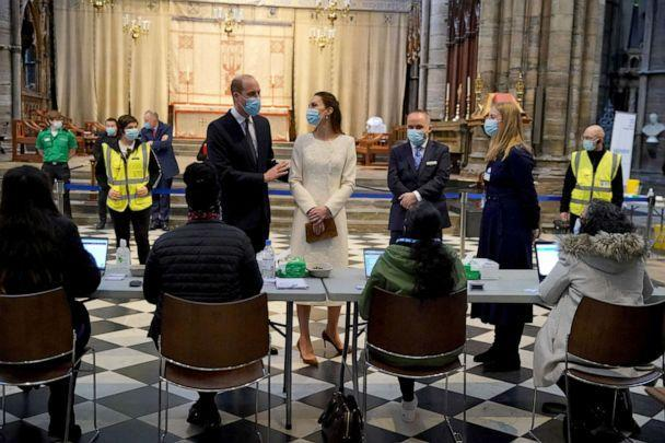PHOTO: Britain's Prince William and Catherine, Duchess of Cambridge, speak to staff during a visit at a coronavirus disease (COVID-19) vaccination centre at Westminster Abbey, in London, March 23, 2021. (Aaron Chown/Pool via Reuters)
