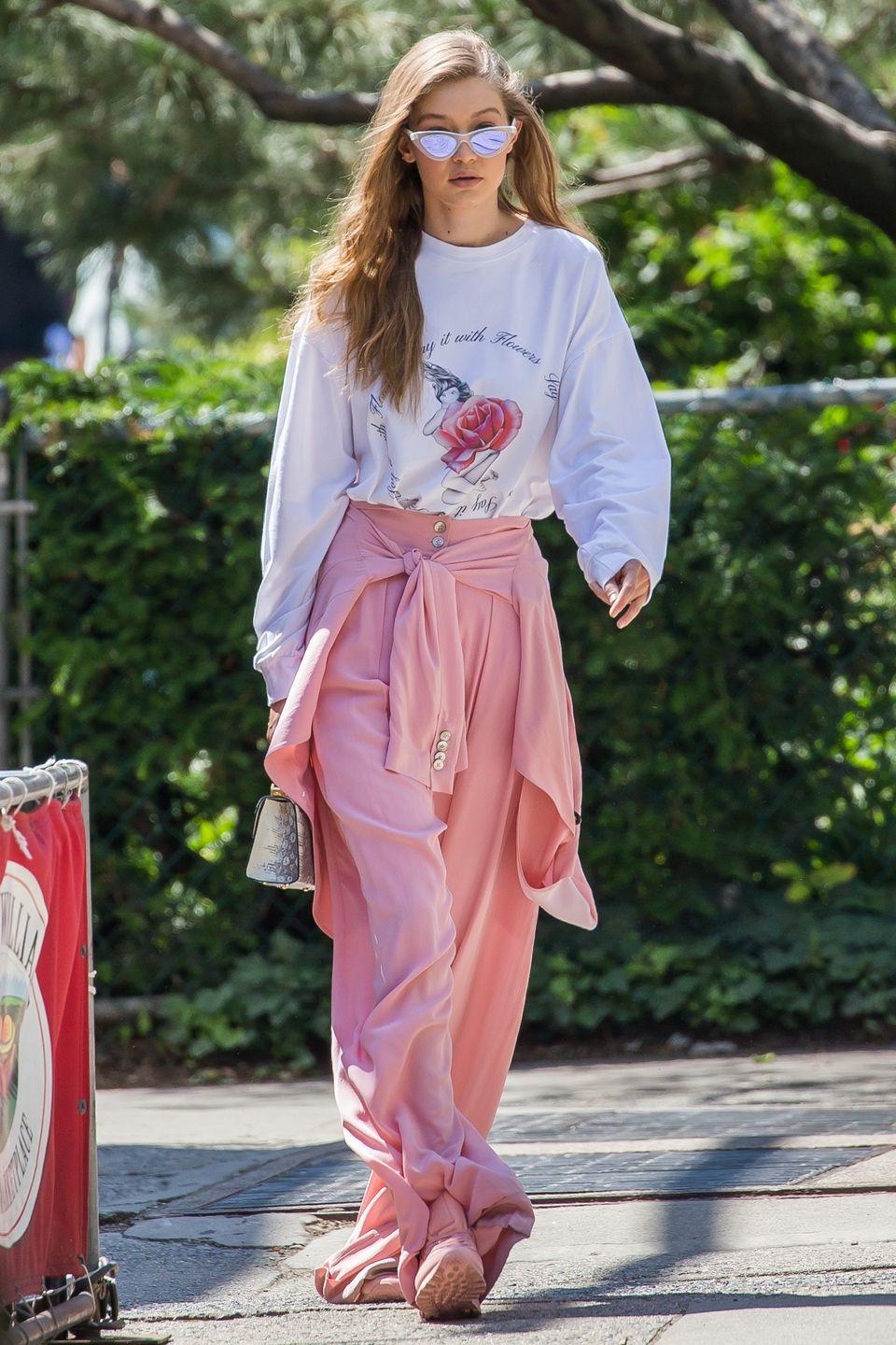 <p>In an Adam Selman graphic long sleeve tee and pink trousers with pink Reebok sneakers, Stalvey bag and Le Specs x Adam Selman cat eye sunglasses while out in New York.<br></p>