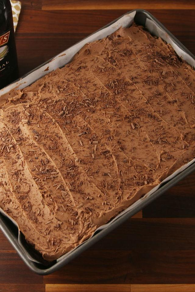 """<p>Chocolate on chocolate.</p><p>Get the recipe from <a rel=""""nofollow"""" href=""""http://www.delish.com/cooking/recipe-ideas/recipes/a56771/baileys-poke-cake-recipe/"""">Delish</a>.</p><p><strong><em>BUY NOW: 9""""x13"""" Baking Pan, $20, <a rel=""""nofollow"""" href=""""https://www.amazon.com/USA-Pan-Bakeware-Rectangular-Aluminized/dp/B0029JOC6I?tag=syndication-20&&ascsubtag=[artid"""">amazon.com</a>.</em></strong></p>"""