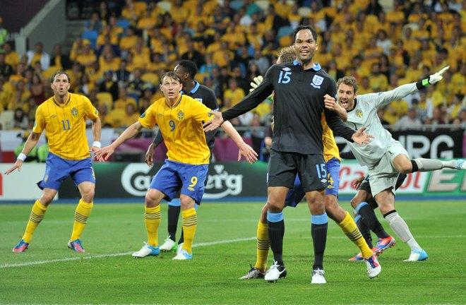 English defender Joleon Lescott (C) waits for a corner during the Euro 2012 championships football match Sweden vs England on June 15, 2012 at the Olympic Stadium in Kiev.    AFP PHOTO / GENYA SAVILOVGENYA SAVILOV/AFP/GettyImages
