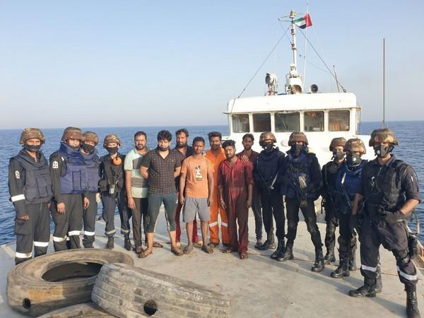 Indian Navy with the rescued crewmen of MV Nayan.