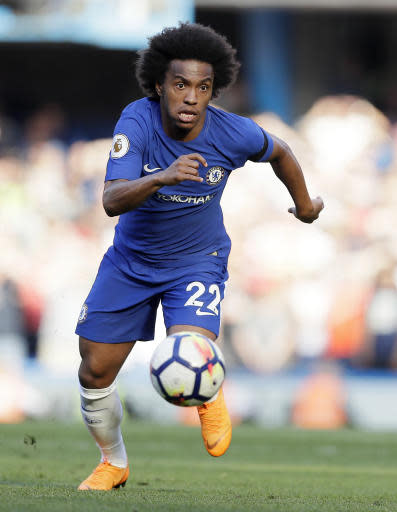 Chelsea's Willian controls the ball during the English Premier League soccer match between Chelsea and Liverpool at Stamford Bridge stadium in London, Sunday, May 6, 2018. (AP Photo/Kirsty Wigglesworth)