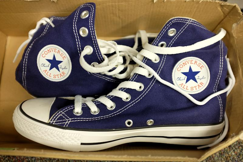 MIAMI, FL - OCTOBER 14: Converse shoes are seen in a store on October 14, 2014 in Miami, Florida. Converse, owned by Nike, announced it is filing lawsuits against 31 companies, accusing them of trademark infringement on its widely recognizable Chuck Taylor shoe. (Photo by Joe Raedle/Getty Images)