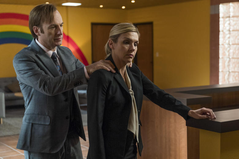 Bob Odenkirk as Jimmy McGill, Rhea Seehorn as Kim Wexler; group†- Better Call Saul _ Season 3, Episode 1 - Photo Credit: Michele K. Short/AMC/Sony Pictures Television