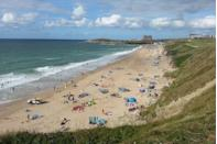 """<p>While every seasoned surfer in the UK will claim a favourite spot, few would argue that Fistral Beach is the country's surfing epicentre. Home to the annual Boardmasters Festival in August and boasting regular waves of more than eight feet, this iconic beach rivals Bondi with its barrel waves and buzzy beach bars.</p><p><strong>Don't Miss</strong>: Eat some of the best fish and chips in Cornwall at <u><a href=""""https://www.rickstein.com/restaurants/fistral/"""" rel=""""nofollow noopener"""" target=""""_blank"""" data-ylk=""""slk:Rick Stein's eponymous eatery"""" class=""""link rapid-noclick-resp"""">Rick Stein's eponymous eatery</a></u>. The casual restaurant is self-service and doesn't take reservations, but there's plenty of space to eat out in the sun.</p>"""