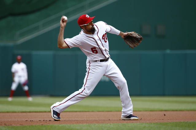 Washington Nationals third baseman Anthony Rendon throws out Colorado Rockies' Trevor Story in the first inning of the first baseball game of a doubleheader, Wednesday, July 24, 2019, in Washington. (AP Photo/Patrick Semansky)