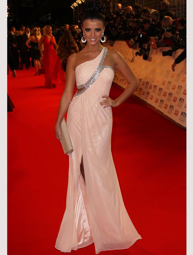 National TV Awards 2012 photos: Lucy Mecklenburgh went for all out glamour in a one-shouldered peach gown. She added an extra edge with a split and cut-out panel.