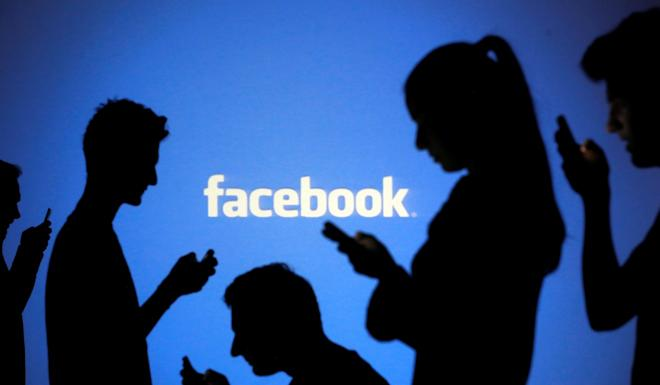 Facebook has a team of 15,000 people around the world to review content, including native speakers of more than 50 languages. Photo: Reuters