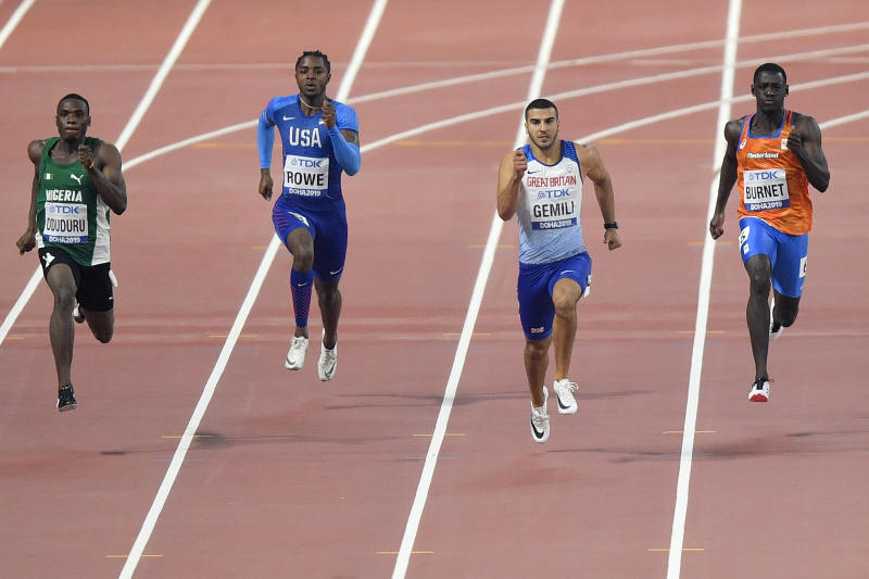 Divine Oduduro, of Nigeria, Rodney Rowe, of the United States, Adam Gemili, of Great Britain, and Taymir Burnet, of the Netherlands,, from left to right, compete in the men's 200 meter heats during the World Athletics Championships in Doha, Qatar, Sunday, Sept. 29, 2019. (AP Photo/Martin Meissner)