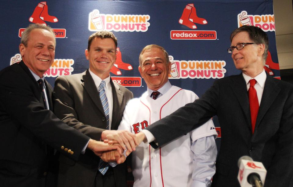 (L-R) President and CEO of the Red Sox Larry Lucchino, Executive Vice President and General manager Ben Cherington, Bobby Valentine and Principal Owner John Henry attend a press conference announcing Valentine as the new manager of the Boston Red Sox during a press conference at Fenway Park on December 1, 2011 in Boston, Massachusetts. (Photo by Elsa/Getty Images)