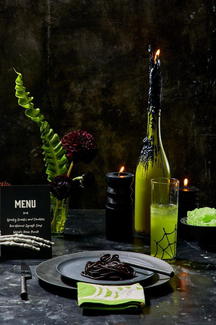 """<p>Go the ghoulish route with a table setting and include black and green accessories, like candles, as well as dark and dramatic floral arrangements.<br></p><p><a class=""""link rapid-noclick-resp"""" href=""""https://go.redirectingat.com?id=74968X1596630&url=https%3A%2F%2Fwww.potterybarn.com%2Fproducts%2Fmason-modern-dinner-plate%2F&sref=https%3A%2F%2Fwww.goodhousekeeping.com%2Fholidays%2Fhalloween-ideas%2Fg33437890%2Fhalloween-table-decorations-centerpieces%2F"""" rel=""""nofollow noopener"""" target=""""_blank"""" data-ylk=""""slk:SHOP BLACK PLATES"""">SHOP BLACK PLATES</a></p>"""