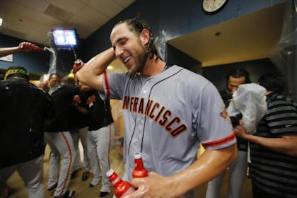 Madison Bumgarner enjoys the spoils of his dominant victory. (AP)