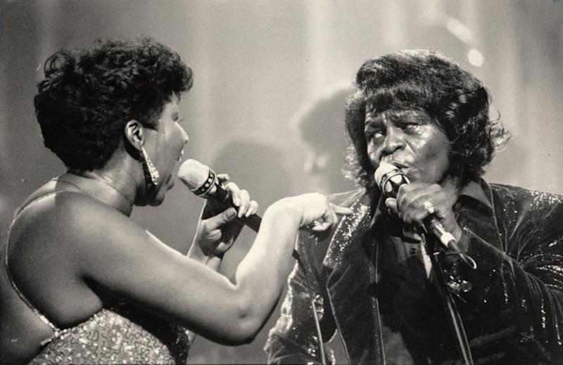 James Brown, right, performs with Aretha Franklin in Detroit, Mich., in January 1987. Brown was known as the Godfather of Soul, while Franklin was known as the Queen of Soul. (Richard Lee/Detroit Free Press/Tribune News Service via Getty Images)